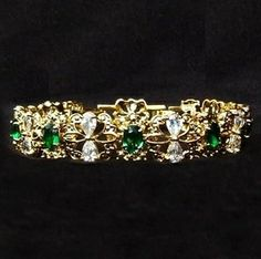 The Garland Bracelet was one of Jackie's favorite pieces given to her by JFK. He gave it to her in October 1962 on the anniversary of their first kiss. It was made up of 9 emeralds and 18 diamonds. She loved that the pattern captured the outline of a butterfly. These beautiful creatures represented the freedom she never had. Years later, she had a second one made with rubies and then finally a third with sapphires. Jackie eventually owned all three of these beloved bracelets at the same…