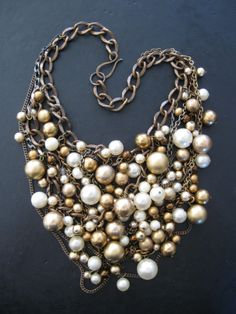 Brass and Pearl Statement Bib Necklace -  Upcycled Vintage Beads - Orbiting. $136.00, via Etsy.