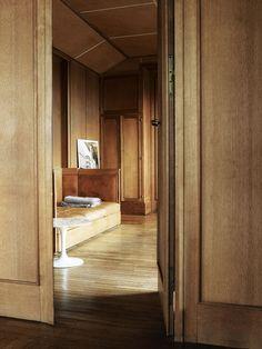 Modern banquette with wooden floors and door