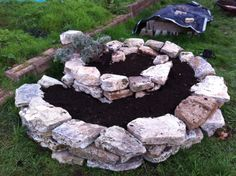 Spiral stacked stone planting bed, good idea for herbs.