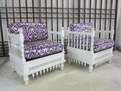 white moroccan chairs with purple ikat fabric