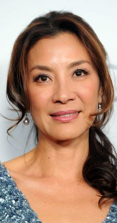 Michelle Yeoh, Actress: Wo hu cang long. Born as Yang Zi Chong in the mining town of Ipoh, in West Malaysia, in the lunar year of the Tiger, Michelle is the daughter of Janet Yeoh and Yeoh Kian Geik, a lawyer and MCA politician. She spoke English and Malay before Chinese. A ballet dancer since age 4, she moved to London, England to study at the Royal Academy as a teenager. After a brief dance career, she won the Miss Malaysia beauty ...