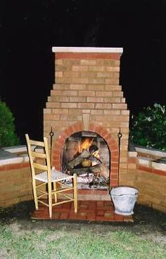 Build an Outdoor Fireplace -   She had never mortared or laid bricks before...and look what she accomplished all on her own!
