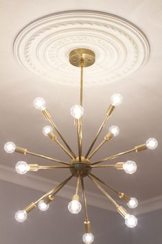 Champagne Lifestyle on a Beer Budget: Before & After: Sputnik Lighting in the Dining Room
