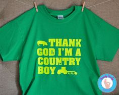 """This fun tee is exactly what your country guy needs. Our made-to-order shirt features neon yellow lettering on a kelly green t-shirt. The text reads Thank God Im A Country Boy and the artwork features farm elements.  All of our products are made to order with a professional heat press. If you'd like a different color combination (see image showing our options), include that info in the """"notes to seller"""" section when you are making your purchase, otherwise shirt will be created as pictured…"""