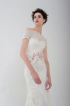"Anny Lin Bridal ""Kalika"" made of French lace with handcrafted floral embellishment. www.annylinbridal.com"