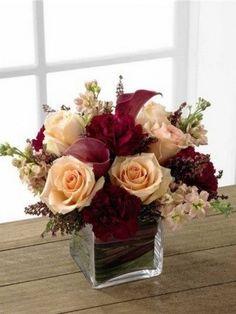 peach and burgundy wedding centerpiece