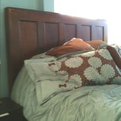 King sized headboard made from a door.