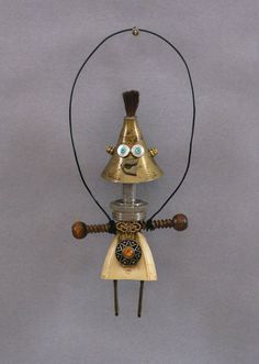 "NANETTE is a one-of-kind robot sculpture. This mini robot hangs on the wall. Nanette is created from found objects which include a plug, rusty nail, jewelry pieces, jewelry beads, miniature funnel, paint brush bristles, electronic piece, and safety pin head. Nanette is not a toy nor is she functional, except to make you smile or laugh!  - SIZE: 5"" tall (includes the wire) by 2"" wide by .75"" deep - Ready to hang - Since my sculptures are made from used found objects, please expect dents…"