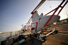 """""""Two MQ-8B Fire Scout drone helicopters get loaded onto the USS Halyburton, August 2011"""" More: http://www.wired.com/dangerroom/2012/12/fire-scout-iphone/"""