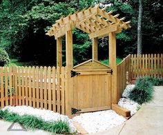 Pictures of Pointed picket fence with fancy gate and gabled walk-through arbor from Atlanta Decking and Fence Company.