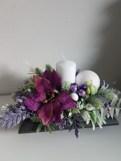 Winter center piece with candle in shades of purple and green Christmas Candle Decorations, Christmas Flower Arrangements, Christmas Candle Holders, Christmas Swags, Colorful Christmas Tree, Holiday Centerpieces, Christmas Flowers, Christmas Candles, Christmas Art