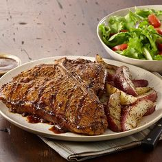 The ultimate steak features a T-bone layered with Montreal Steak Seasoning and Steak Sauce. Serve with seasoned grilled potatoes.