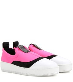 McQ Alexander McQueen - Slip-on sneakers - McQ Alexander McQueen's slip-on sneakers in a hot pink scuba upper and contrasting white sole are a street-style addition to urban ensembles. Black suede panelling and a black leather tab finish this look off with signature irreverence. seen @ www.mytheresa.com