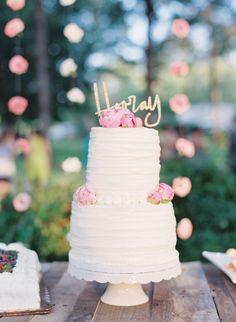 hooray cake topper, photo by Cassidy Carson http://ruffledblog.com/louisiana-backyard-wedding #weddingcake #cakes