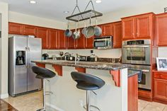 Kitchen - granite counter tops - island - leather stools - stainless steel appliances - double oven - southern california home Granite Kitchen, Granite Countertops, Kitchen Cabinets, California Homes, Southern California, Leather Stool, Stainless Steel Appliances, Counter Tops, Stools