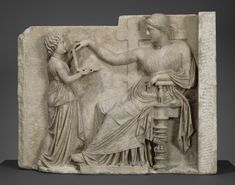Is this ancient Greek woman checking Facebook on her so-called laptop?