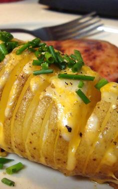 Recipe for Cheesy Fan Potatoes - Here is an easy and delicious side dish! We loved it and I can't believe I have never eaten potatoes this way before.