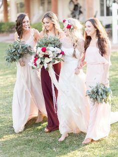 bridesmaids in blush pink and burgundy - photo by Kristen Joy Photography http://ruffledblog.com/boho-ranch-wedding-inspiration