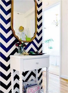 Navy + white chevron wall with brass mirror