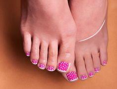close up of hot pink and polka-dot toenails
