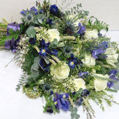 Wild, Scottish and Natural Hand-tied Sheaf includes flowers such as Iris, Waxflower, Veronica and Roses mixed with textural elements such as blue Thistles and Eucalyptus. Iris Wedding Bouquet, Bride Bouquets, Wedding Flowers, Wild Flower Arrangements, Funeral Floral Arrangements, Casket Flowers, Funeral Flowers, Scottish Flowers, Memorial Flowers