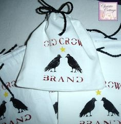 "Jewelry Bags, Old Crow Brand, Handmade Set of 15 Details This cute set of handmade jewelry bags or soap bags are perfect for any shop using the name ""Crow"" or ""Raven"". Packing your items with a personal touch! Even have had them ordered for a wedding shower! They have been handmade from a well worn white sheet. The fabric has rust spots on it which add to the character of the bags."