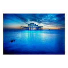 Wasteland :- Shot on the 15th November 2013 at 16:45 pm during a very low tide on Brighton beach. The light was beginning to fade quite rapidly but it had given the seawater a ghostly neon blue sheen. The ruins of the West Pier stood resplendent amongst the glow and looked stunning. #pier #ruin #frame #metal #sea #neon #blue #water #england #brighton #decay #beauty #sunset #sundown #twilight #sheen #glow