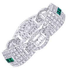 Diamond and Emerald Gold Bracelet | From a unique collection of vintage link bracelets at http://www.1stdibs.com/jewelry/bracelets/link-bracelets/