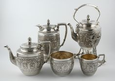 Dating from the late Victorian era this five piece set was made in Scotland in 1898. It is in the 'Indian style' and was produced by James Murray who was based in Glasgow. This style was popularised after the Glasgow Exhibition of 1876. It consists of a tea pot, coffee pot, milk jug and sugar bowl as well as a tea kettle on stand. This has a burner underneath to keep the water boiling at the table.