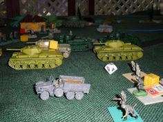 German troops run for it past Russian KV tanks! More Germans defend in the background and it was these and the German guns that stopped the Russian attack. Tanks don't do so well without infantry support and the Russian infantry was still to come on.