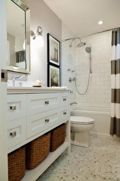 Love the tile, shower, colour, pictures and baskets!