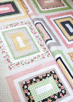 Kith & Kin quilt by Lella Boutique. Made with 1 Jelly Roll (2 1/2'' strips) and 9 fat quarters. Fabric is Farmer's Daughter by Lella Boutique for Moda Fabrics, shipping Oct 2017.