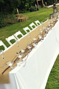 Country Wedding- wedding party table (white lights hidden behind tablecloth for night time