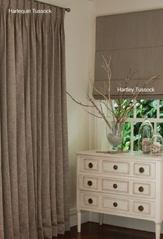 CurtainStudio Harlequin Tussock. Create a sense of elegance with floor to ceiling curtains. We have combined curtains with a contrasting blind in a darker colour for extra depth and light control.