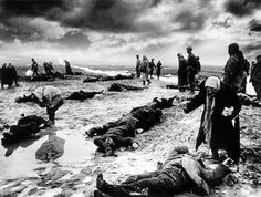 """Not much is known about this iconic World War II photograph, but to many it is instantly recognizable, and is titled simply """"Grief"""". The photograph was taken by Soviet photographer Dmitri Baltermants. He photographed many Soviet battles including Stalingrad, and he himself was wounded twice. All of his photographs were censored by the Red Army. Only the ones that fit into the Soviet propaganda campaign would be published. Though this photograph was sent around the world during WWII"""