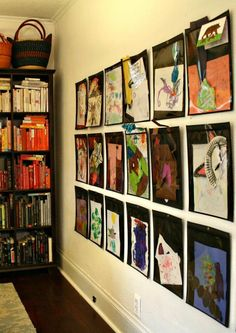 "The couple created a gallery wall to hold an ever-changing display of the kids' artwork. ~but where can I buy the ""plastic envelope sheaths""? Tattoo Tarot, Art For Kids, Crafts For Kids, Kid Art, Abc Crafts, Interior Design Degree, Artwork Display, Displaying Kids Artwork, Artwork Wall"
