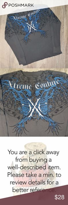Xtreme Couture by Affliction graphic t-shirt L Condition: Great. Barely worn. After careful inspection, no signs of stains, tears or flaws. Size Large. Waffle terry cloth. Measures 21 inches from pit to pit and is 26 inches long. All measurements taken with garment laying flat. Images represent exactly how product/s look/s like. Ships within 24 hours after purchasing. Xtreme Couture by Affliction Shirts Tees - Long Sleeve