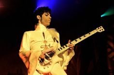 Prince performing with a pearl white Warwick Streamer 4 string.