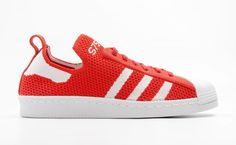 The adidas Superstar 80s takes on a bright red colorway with a Primeknit upper