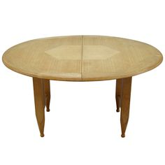 1950s Oval Table by Guillerme et Chambron | From a unique collection of antique and modern dining room tables at https://www.1stdibs.com/furniture/tables/dining-room-tables/