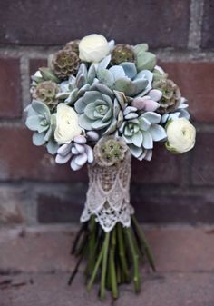 silver gray bouquet of mostly suculents (must have been VERY heavy!) scabosa pods and a few ranunculus.