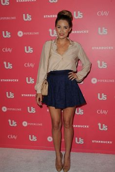 button up blouse high waisted skirt and high bun, way to make casual look dressy.