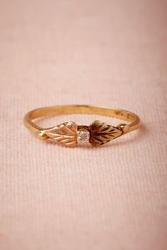 love this tiny diamond and gold ring. bigger is not always better