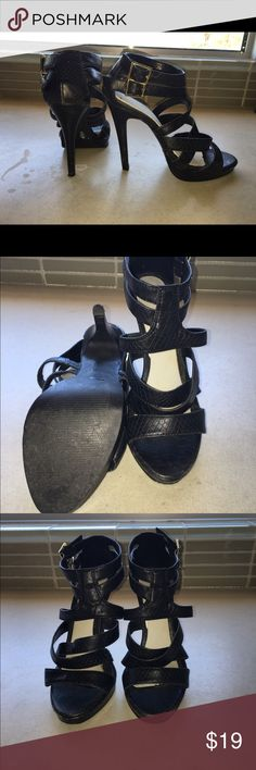 One pair black hi heeled sandals Very cute pair of black strappy sandals with little gold buckle at double strap sides. Slight platform at front. Faux snake. Heel height is 4-1/4 inches. Worn twice, very minimal wear, very good condition. Michael Antonio Shoes Sandals
