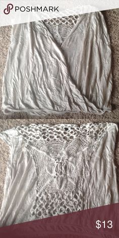 Lace back top The bottom is tight fitting, may fit a medium or large better depending on your style. Super cute and in excellent condition. Living doll brand Tops
