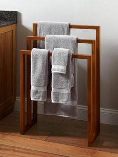 Simple lines and contemporary design make the Hailey Teak Towel Rack a smart choice for drying towels, swimsuits, and other wet items. It's perfect for a bathroom styled with modern decor.