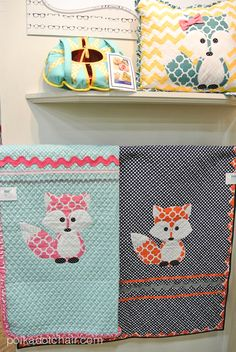 Riley Blake Fabrics Display at Quilt Market: Riley Blake Quatrefoil Fox Quilts #rileyblakedesigns #quatrefoil #fox