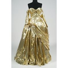 """Edith Head's gold dress for Grace Kelly in the costume ball sequence of Alfred Hitchcock's """"To Catch a Thief."""" Upon seeing Kelly in this gown, the director remarked, """"Grace, there's hills in them thar gold!"""""""