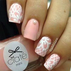 Peachy Nails with Pretty White Lacy Details.